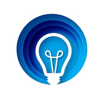 Glühbirne im papierhandwerksstil. origami glühbirne. leuchtend weiße farbe für kreativität, startup, brainstorming, business. kreis blau geschichteten rahmen. .