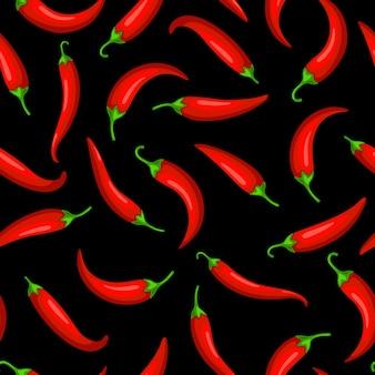 Glühende chilischoten auf schwarzem hintergrund