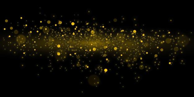 Glühende gelbe bokehkreise, funkelnder goldener staub abstrakte goldene luxushintergrunddekoration