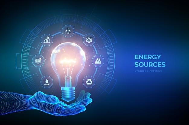 Glühende glühbirne mit energieressourcenikonen in der hand. strom- und energiesparkonzept. energiequellen.
