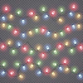 Glühende weihnachtslichter isoliert. satz farbige girlanden.