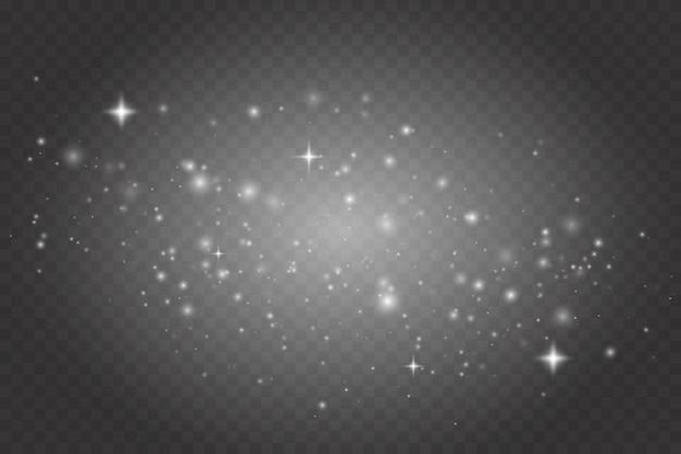 Glühender lichteffekt mit vielen glitzerpartikeln, die auf transparentem hintergrund isoliert sind. funkelnde magische staubpartikel.