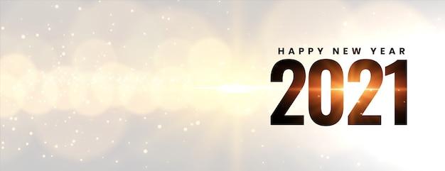 Glühendes frohes neues jahr 2021 auf bokeh-lichteffekt