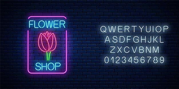 Glühendes neonschild des blumenladens im rechteckigen rahmen mit alphabet