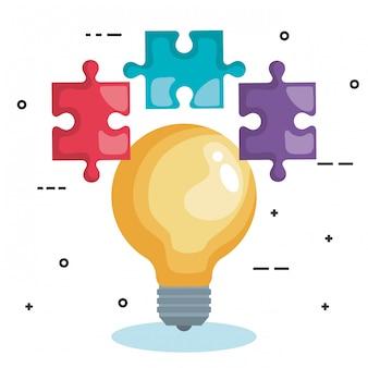 Glühlampe mit puzzlespielstücken