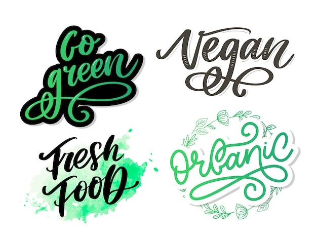 Go green kreatives öko-konzept. naturfreundlicher pinselstift-beschriftungssatz