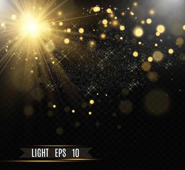 Gold funkelt, magischer, heller lichteffekt auf einem transparenten hintergrund. goldstaub.