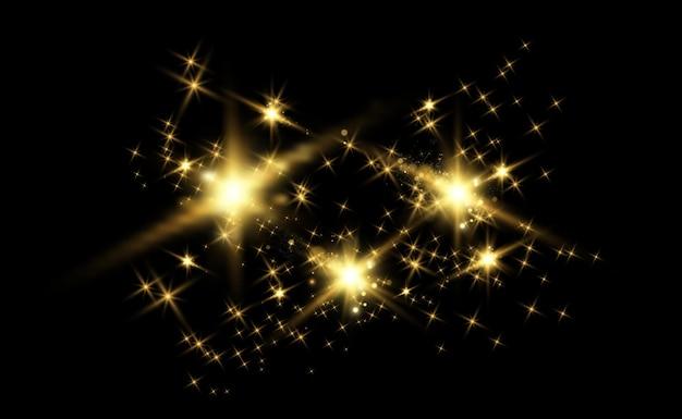 Gold funkelt, magischer, heller lichteffekt auf einem transparenten hintergrund.
