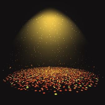 Gold-star konfetti unter einem scheinwerfer