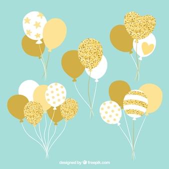 Gold- und weißballonbündelsammlung