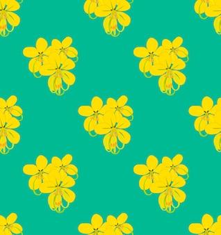Goldene duschblume auf grünem aquamarinem hintergrund