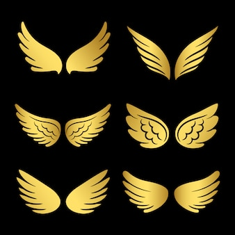 Goldene flügelsammlung. engelsflügel lokalisiert auf schwarzem