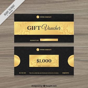 Goldene geschenk-gutscheine in schwarzer farbe