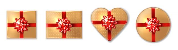 Goldene geschenkbox mit roter schleife