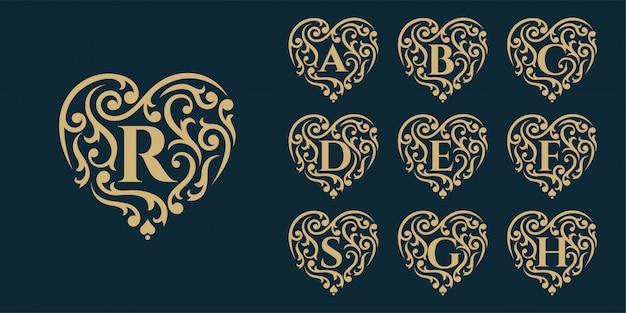 Goldene luxus-logo-vorlage. weinlesedesignlogoikonenkonzeptliebe auf dunklem hintergrund.