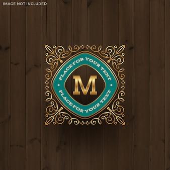 Goldene monogramm-logo-schablone mit den kalligraphischen eleganten verzierungselementen des schnörkels.