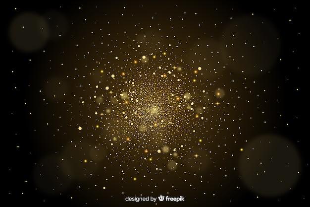 Goldene partikel verwischten dekorativen hintergrund