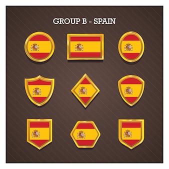 Goldene rahmenabzeichen mit weltcuplandflaggen - spanien