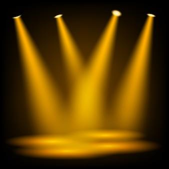 Goldene scheinwerfer, die auf dunklem hintergrund glänzen