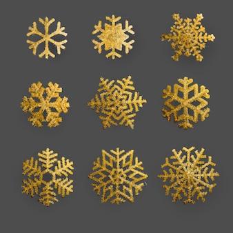 Goldene und funkelnschneeflocken weihnachtsverzierung stellte auf hintergrund ein