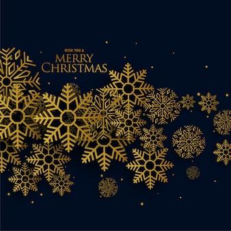 Goldene weihnachtsschneeflocken auf schwarzem hintergrund