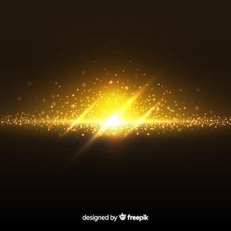 Goldener explosionspartikeleffekt auf schwarzen hintergrund