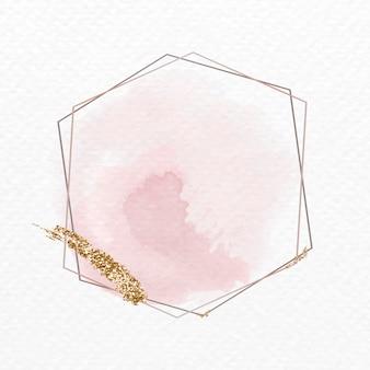 Goldener glitzerfleck auf einem sechseckigen rahmen Kostenlosen Vektoren