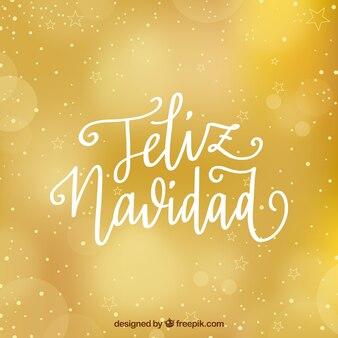 Goldener hintergrund mit beschriftung der frohen weihnachten