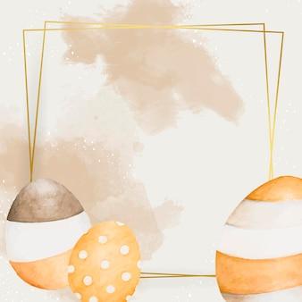 Goldener osterrahmen mit eiervektor