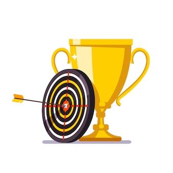 Goldener Pokal mit Pfeil, der in der Zielmitte schlägt