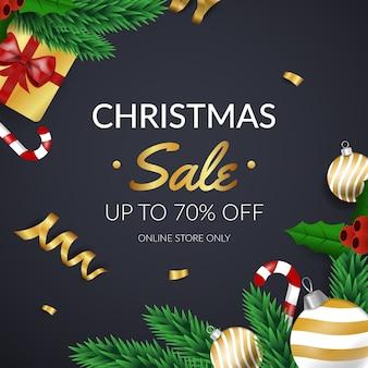 Goldener weihnachtsverkauf mit kiefernblättern und -geschenken
