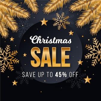 Goldener weihnachtsverkauf mit kiefernblättern und -schneeflocken