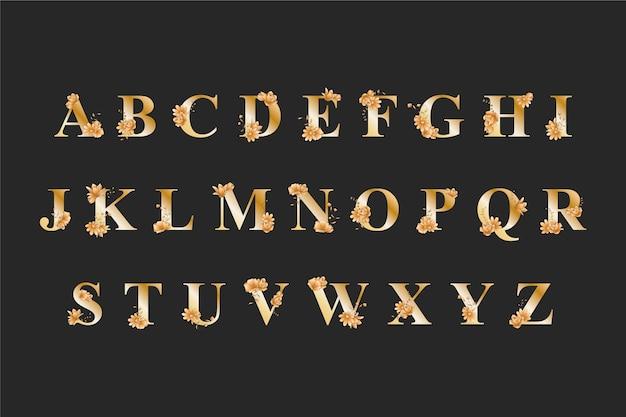 Goldenes alphabet mit eleganten hochzeitsblumen