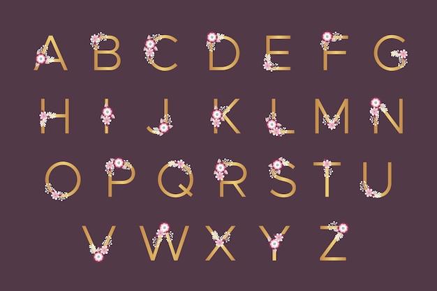 Goldenes alphabet mit frühlingsblumen für die heirat