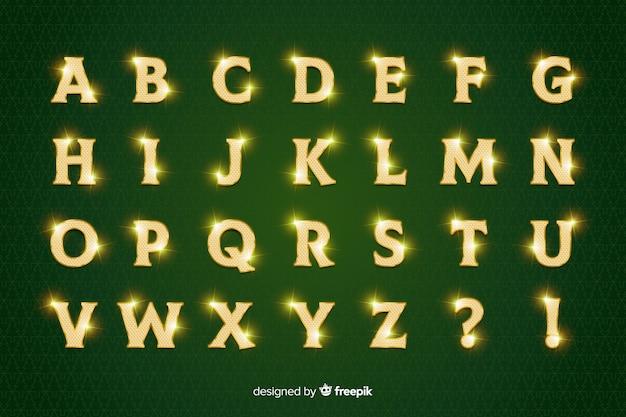 Goldenes funkelndes weihnachtsalphabet auf grünem hintergrund