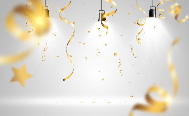 Goldenes konfetti. fallende luftschlangen auf der bühne.