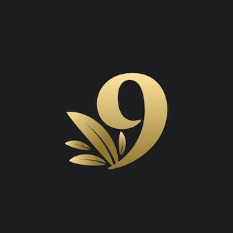 Goldenes nummer-neun-logo mit goldenen blättern. natürliches logo der nummer 9 mit blattgold.