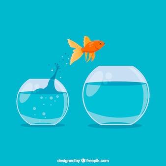 Goldfisch, der aus goldfischglas in der flachen art heraus springt