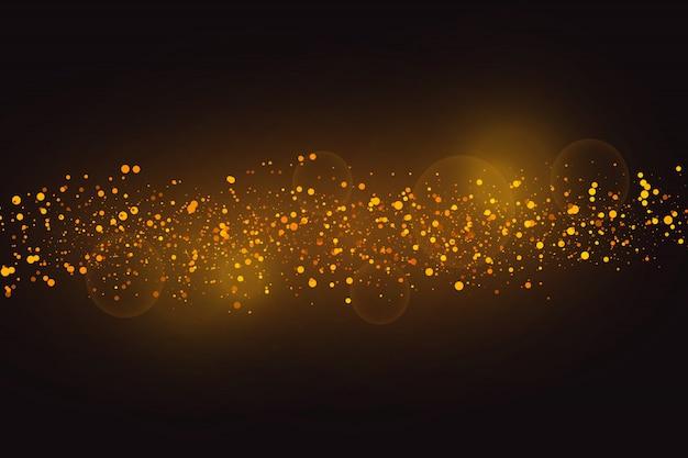 Goldfunken und goldene sterne glitzern als besonderer lichteffekt.