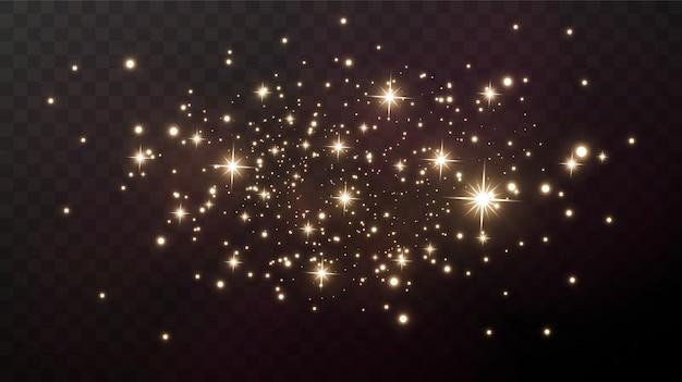 Goldfunken und goldsterne funkeln mit einem besonderen lichteffekt.