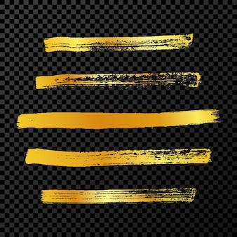 Goldgrunge-pinselstriche. set aus fünf bemalten tintenstreifen. tintenfleck auf dunklem transparentem hintergrund isoliert. vektor-illustration