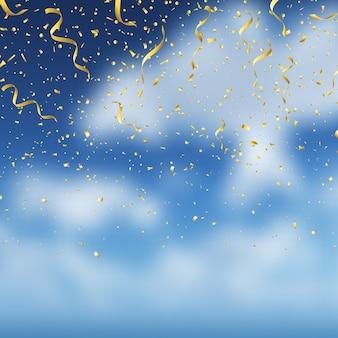 Goldkonfetti auf blauem himmelhintergrund