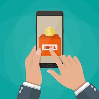 Goldmünze und spendenbox auf dem smartphone-bildschirm.