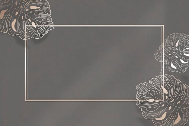 Goldrahmen mit monstera-blattmusterhintergrund