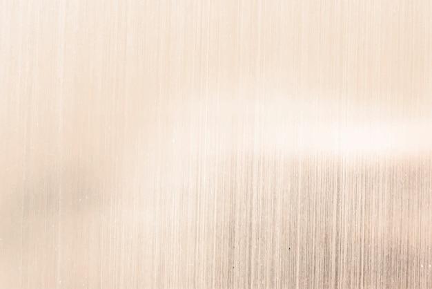 Goldschimmernder papierhintergrund