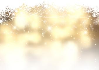 Goldweihnachtshintergrund mit Schneeflocken