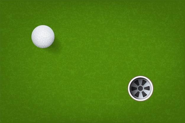 Golfball und golf loch.