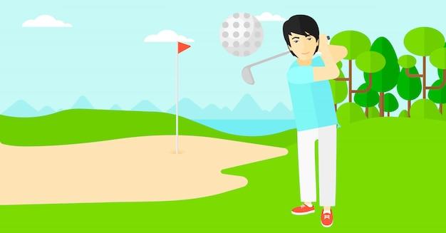 Golfspieler, der den ball schlägt.