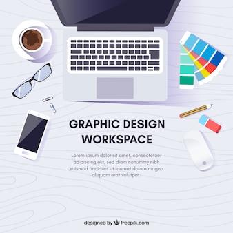 Grafikdesignarbeitsraumhintergrund mit schreibtisch und werkzeugen