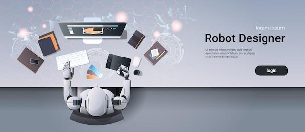 Grafikdesigner-roboter, der an der webvorlage des kreativen entwurfsarbeitsplatzes sitzt